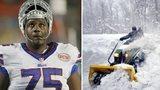 Buffalo Bills players use snowmobile