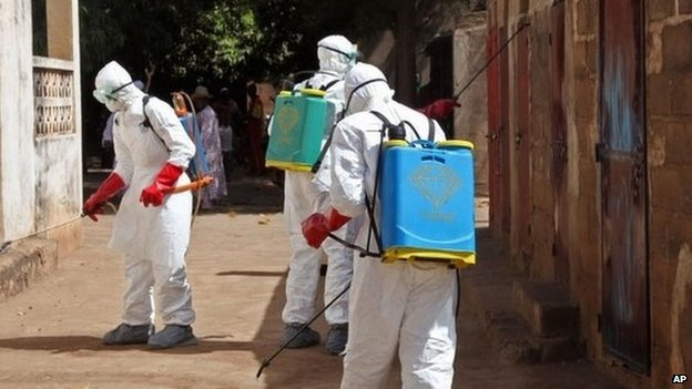 Health workers spray disinfectant a street in Bamako, Mali. Photo: November 2014