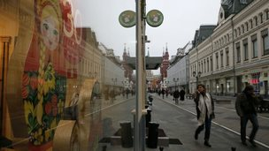 People walk past a store in central Moscow 12 November.