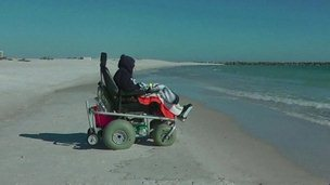 100-year-old Ruby Holt in her chair watching the ocean waves