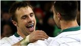 Tommy Bowe celebrates scoring for Ireland with scrum-half Conor Murray