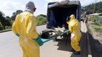 Health workers take a patient to an Ebola treatment centre, Macenta, Guinea, 21 November 2014