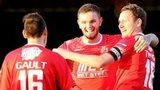 Portadown players congratulate Darren Murray after he opens the scoring at Stangmore Park