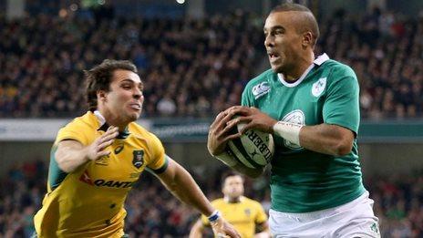 Simon Zebo runs in Ireland's first try despite Nick Phipps's efforts