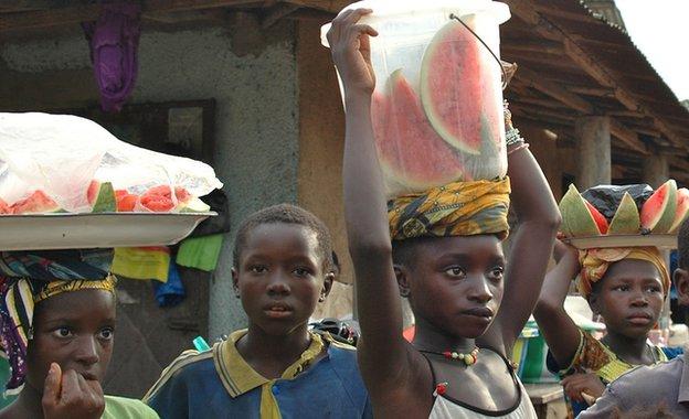 Children selling watermelon slices in Guinea, 21 November 2014
