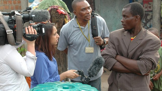 The BBC interview a man in Maferiah, Guinea, 21 November 2014