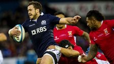 Alex Dunbar is challenged by Tonga's Latiume Fosita (right).