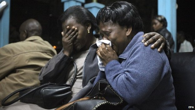 Relatives of those who were killed cry as the bodies of their loved ones arrive at Chiromo mortuary in Nairobi, Kenya - 22 November 2014
