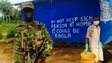 A soldier and a health worker at an Ebola checkpoint, Sierra Leone, 21 November 2014
