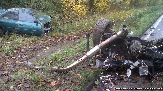Smash 'splits family's car in two'...