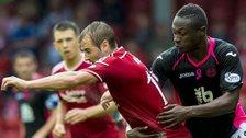 Aberdeen's Niall McGinn and Partick Thistle's Abdul Osman