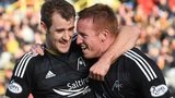 Niall McGinn and Adam Rooney celebrate