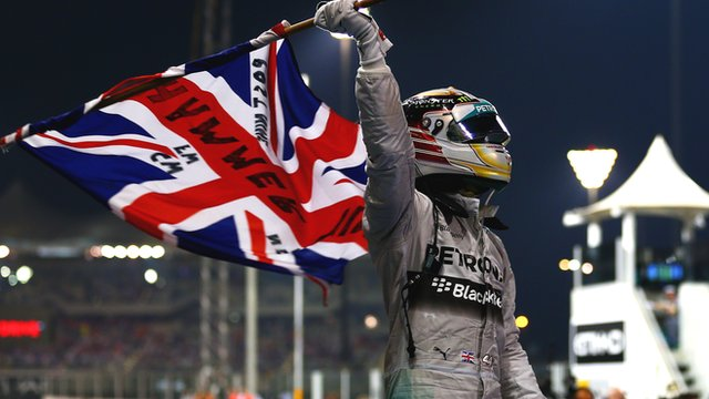 Lewis Hamilton celebrates after winning second title
