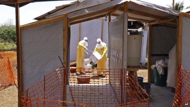 Medecins Sans Frontieres members prepare Ebola isolation and treatment areas for their Ebola in Gueckedou, Guinea. Photo: March 2014