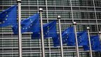 European Union flags are pictured outside the European Commission building