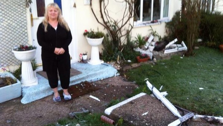 Pauline Worrall outside her house