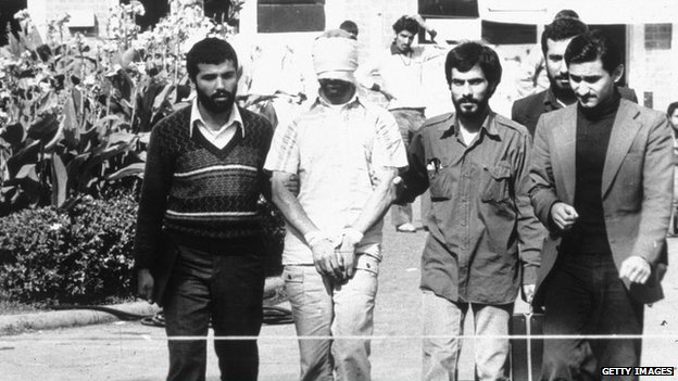 An American hostage being paraded before the cameras by his Iranian captors (November 1979)