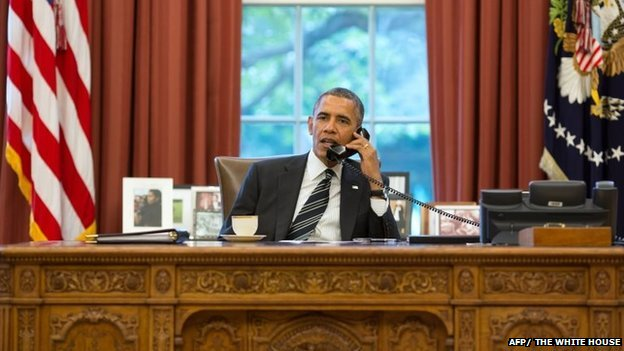 President Obama talks on the telephone to President Hassan Rouhani of Iran from the Oval Office on 27 Sept 2013