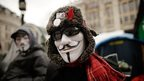 Occupy protester in V for Vendetta mask