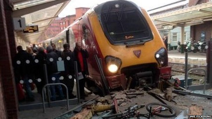 Train crashes into barrier