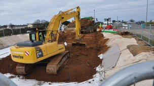 Soil contaminated with PFOS being buried in a bund by the entrance to Guernsey Airport