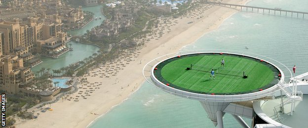 Roger Federer and Andre Agassi play tennis on the helipad of the Burj Al Arab hotel