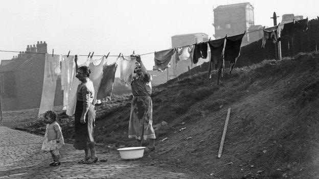 Women hang washing