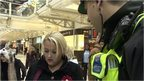 British transport policeman speaking to a member of the public