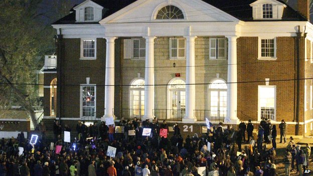 Protestors gather outside the Phi Kappa Psi fraternity at the University of Virginia on Saturday night