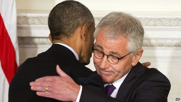 President Barack Obama and Defence Secretary Chuck Hagel embrace after speaking about Hage's resignation during an event in the State Dining Room of the White House in Washington on 24 November 2014