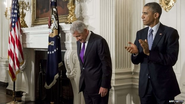 US Secretary of Defence Chuck Hagel bows his head alongside US President Barack Obama after announcing his resignation in the State Dining Room of the White House in Washington in November 2014