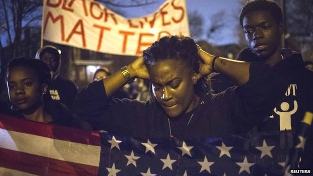 Protesters, demanding the criminal indictment of a white police officer who shot dead an unarmed black teenager in August, march through a suburb in St.</body></html>