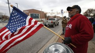 Two men demonstrate across from the Ferguson Police Department in Ferguson, Missouri, USA, 24 November 2014