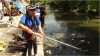 Workers in Manila cleaning up river