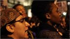 Close up of faces of New York protesters following grand jury decision not to indict officer who shot Michael Brown