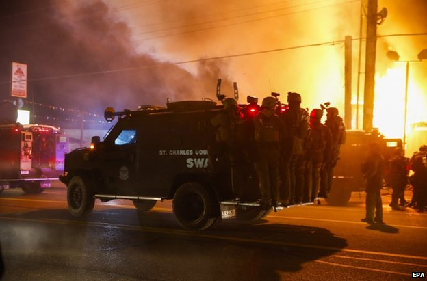 Riot police on a vehicle in Ferguson, 24 November