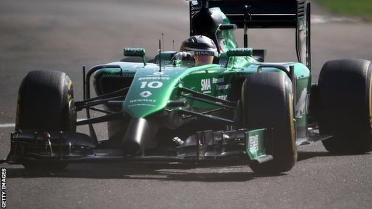Caterham car of Kamui Kobayashi competing at the Abu Dhabi Grand Prix