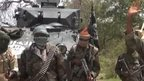 Screengrab showing Nigerian Islamist militants taken from a Boko Haram video