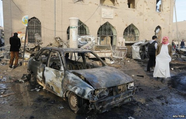 Aftermath of what activists said was a Syrian government air strike near the Raqqa museum on 25 November 2014