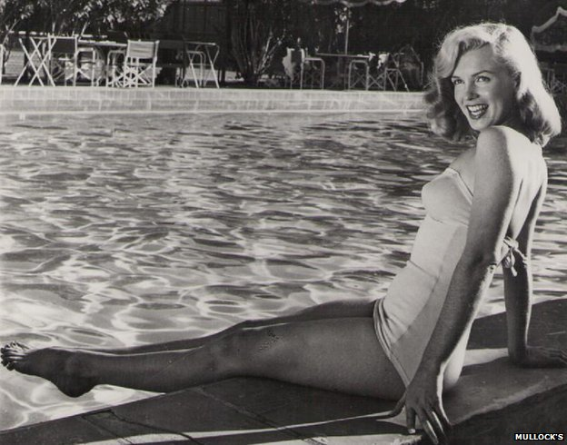 Marilyn Monroe was pictured by the side of a swimming pool in a photo with the stamp of Bruno Bernard, Globe Photos