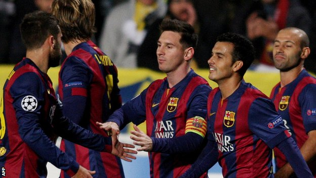 Lionel Messi celebrates scoring against Apoel Nicosia