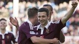 Hearts players celebrate a goal