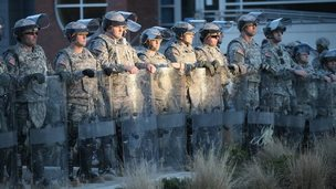 Soldiers with the Missouri National Guard stand guard outside the Ferguson police station on 25 November 2014 in Ferguson, Missouri