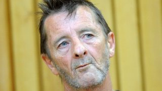 BBC News - AC/DC drummer Phil Rudd appears late in court in NZ