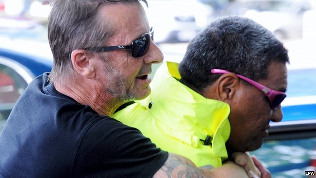 Phil Rudd leaves the District Court in Tauranga, New Zealand, 26 November 2014