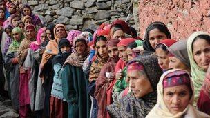 Kashmiri nomad voters queue outside a polling station in Babanagri on November 25, 201