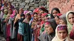 Kashmiri nomad voters queue outside a polling station in Babanagri on November 25, 201