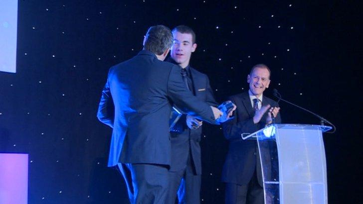 Josef Craig receiving his award