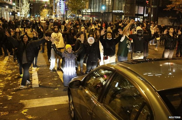 Protesters in Seattle block a road, 25 November