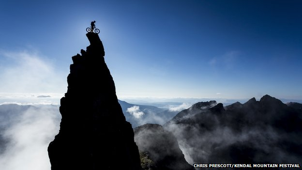 A cyclist on top of the Inaccessible Pinnacle